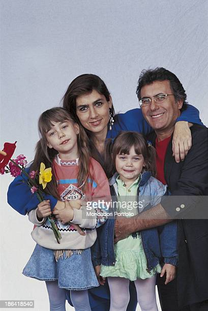 The italian singer Al Bano born Albano Carrisi smiles with his wife Romina Power and the daughters Cristel and Romina jr Italy 1996