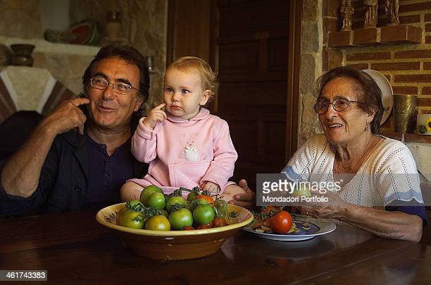 The italian singer Albano Carrisi in art Al Bano plays with his daugther Jasmine and the mother Iolanda in his estate in Cellino San Marco Cellino...
