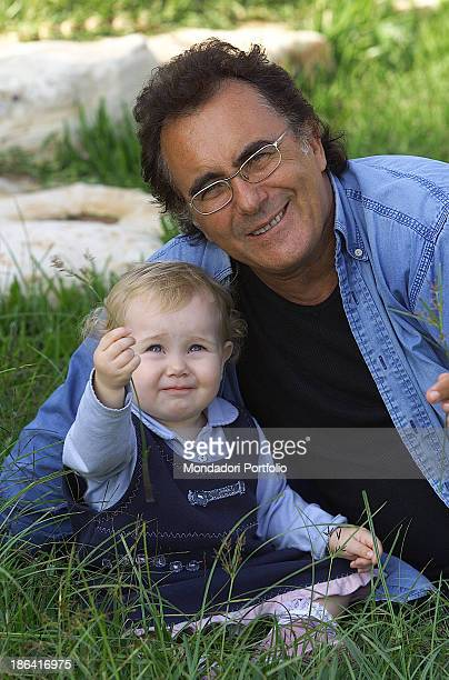The italian singer Albano Carrisi in art Al Bano relaxes and plays in the garden of his estate with the daughter Jasmine Cellino San Marco 2002