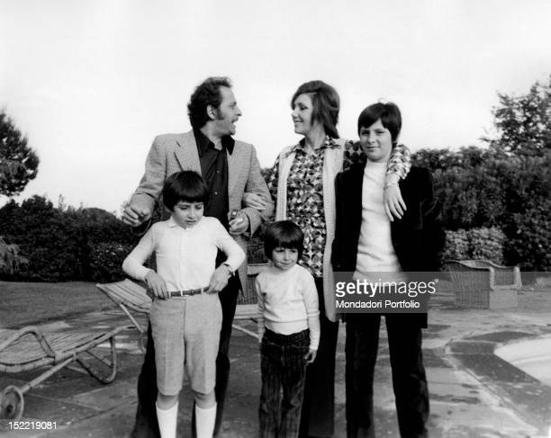 The Italian singer and actor Domenico Modugno posing for a photograph with his wife the Italian actress Franca Gandolfi and their children Marcello...