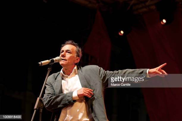The italian singer and songwriter Roberto Vecchioni during a concert in Naples