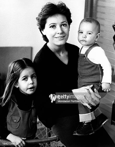 The Italian singer Anna Identici posing with her daughters Susanna and Rossella Milan 1980s
