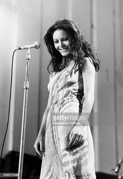 The Italian singer Anna Identici singing during the Naples Music Festival Capri July 1970