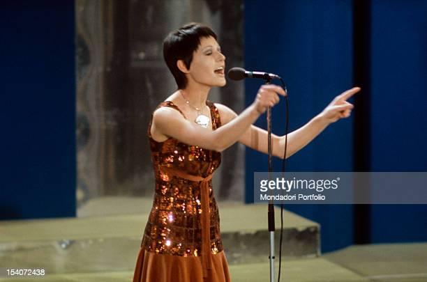 The Italian singer Anna Identici singing on the stage of Teatro Ariston during the Sanremo Music Festival Sanremo 1971