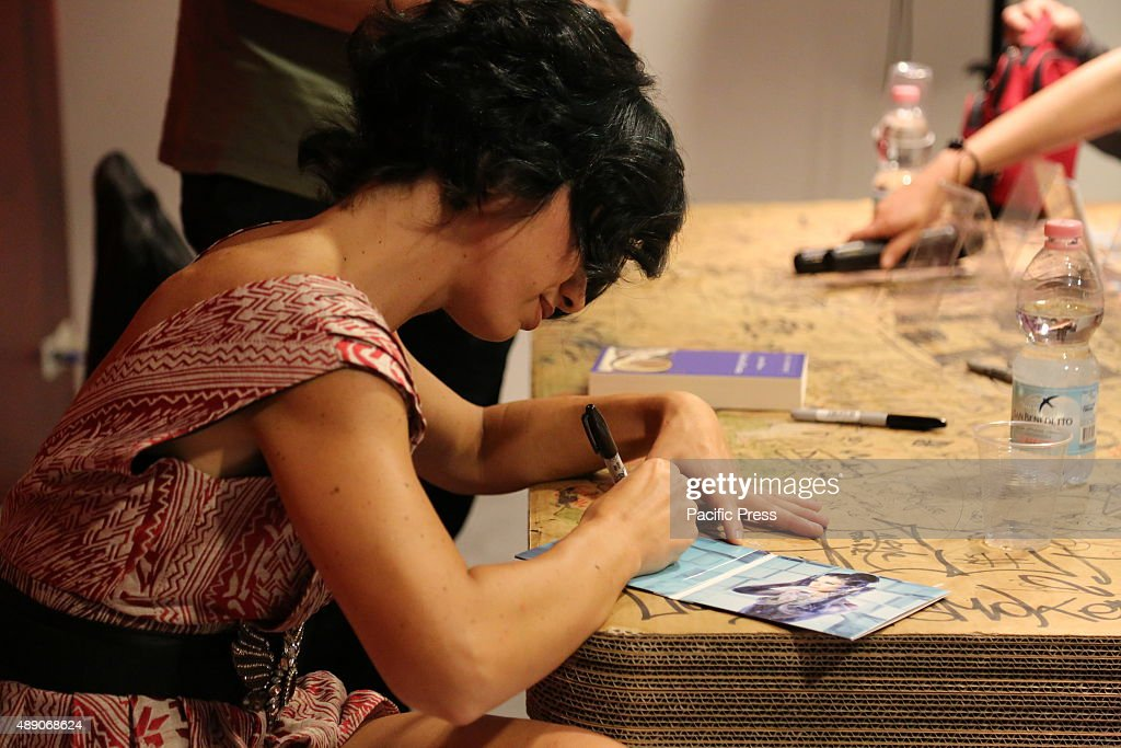 the italian singer dolcenera signs a copy of her new album titled