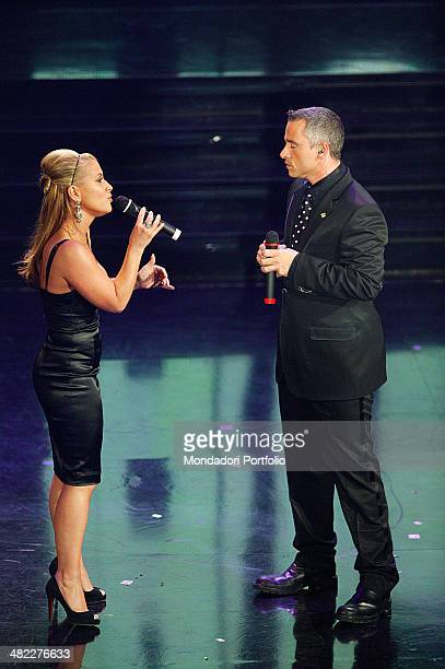 The Italian singer Eros Ramazzotti and American singer Anastacia singing ' I Belong to you ' during the 56th Sanremo Music Festival San Remo Italy...