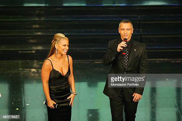 The Italian singer Eros Ramazzotti and American singer Anastacia on the stage after singing ' I Belong to you to 56th Sanremo Music Festival San Remo...