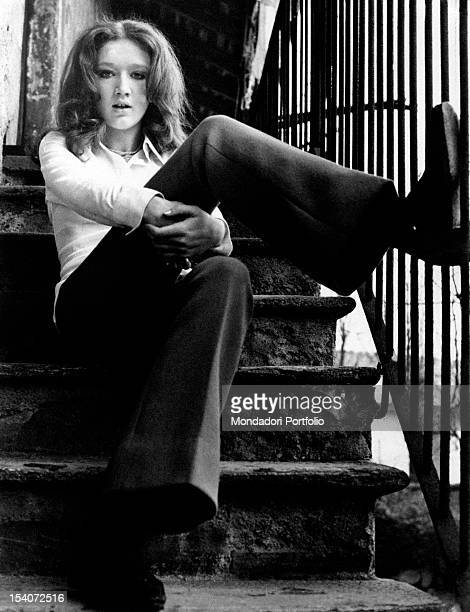 The Italian singer Fiorella Mannoia posing sitting on a filght of steps April 1969