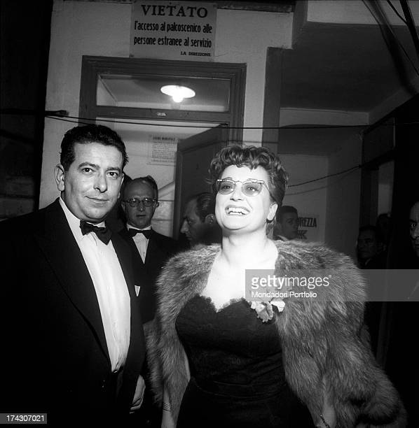 The Italian singer Flo Sandon's born Mammola Sandoni is smiling at the IV Sanremo Music Festival next to her partner the Italian singer Natalino Otto...
