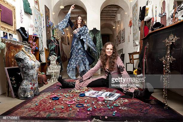 The Italian singer Irene Fornaciari dances in the shop of her sister Alice her personal stylist wearing hippy dresses Sarzana March 10 2011