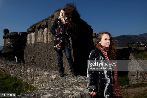 The Italian singer Irene Fornaciari pose in front of Fort Sarzanello with her sister her personal stylist Alice Fornaciari Both are Zucchero...