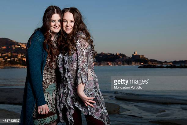 The Italian singer Irene Fornaciari smiles beside her sister her personal stylist Alice Fornaciari Both are Zucchero's daughters Lerici March 10 2011