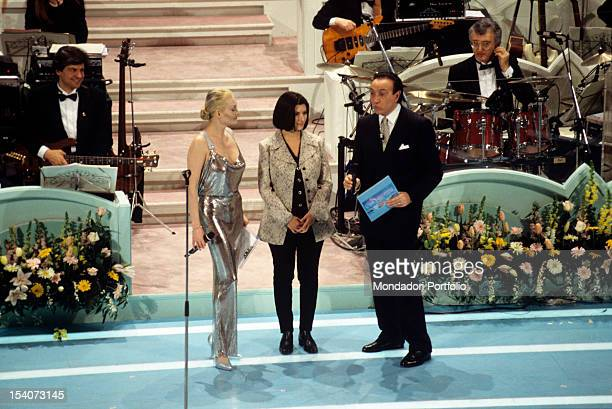 The Italian singer Laura Pausini is presented by the Italian singer and presenter Anna Oxa and the Italian presenter Pippo Baudo during the Sanremo...