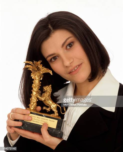 The Italian singer Laura Pausini showing the prize received for third place in the Sanremo Music Festival Sanremo 1994