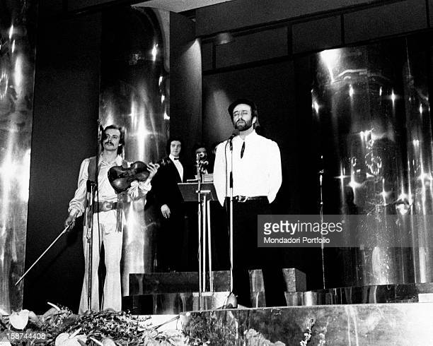 The Italian singer Lucio Dalla is singing the song titled 4 marzo 1943 on the stage of the Sanremo Music Festival Sanremo Italy 1971