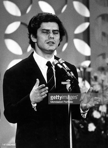 The Italian singer Luigi Tenco at Sanremo festival singing the song 'Ciao Amore Ciao' Sanremo January 1967