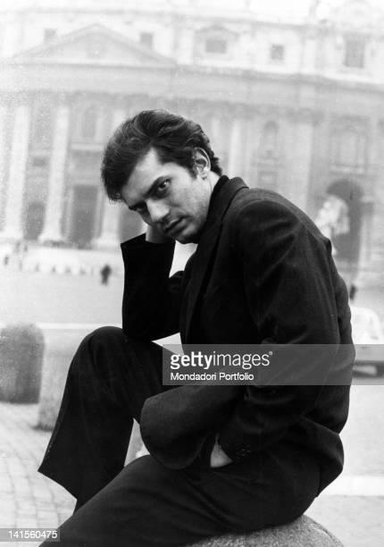 The Italian singer Luigi Tenco sitting in San Pietro square State of the Vatican 1967