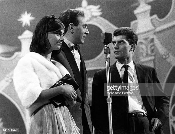 The Italian singer Luigi Tenco talking with the Italian TV presenter Pippo Baudo during a show Rome