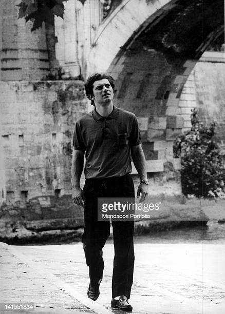The Italian singer Luigi Tenco walking along the Tiber river Rome 1966