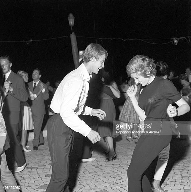 The Italian singer Mina dancing the twist in a club with an unknown boy Capri 1960