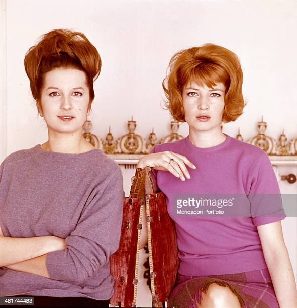 The Italian singer Mina is posing next to the Italian actress Monica Vitti on the set of the film Eclipse directed by Michelangelo Antonioni Mina...