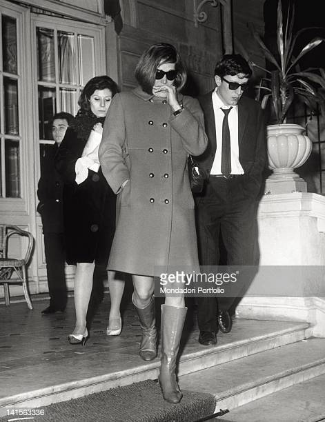 The Italian singer, naturalized French, Dalida, after the death of her partner Luigi Tenco, with a group of people. Sanremo, 27th January 1967.