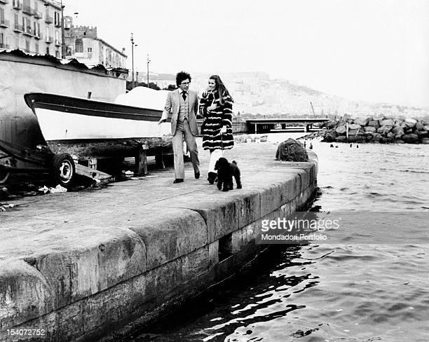 The Italian singer Peppino di Capri walking with his wife Giuliana Gagliardi Naples 1970s