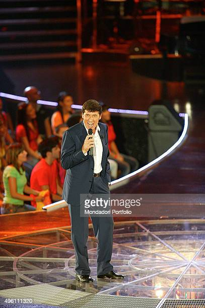 The Italian singer presenter and actor Gianni Morandi singing at his musical itinerant programme Non facciamoci prendere dal panico in an indoor...