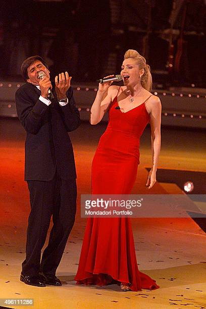The Italian singer, presenter and actor Gianni Morandi singing with the Italian presenter, showgirl and singer Lorella Cuccarini during the...