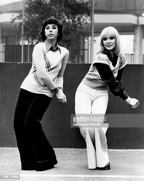 The Italian singers and actresses Daniela and Loretta Goggi are doing some dance moves accompanying the song by Loretta titled Mani Mani one of the...