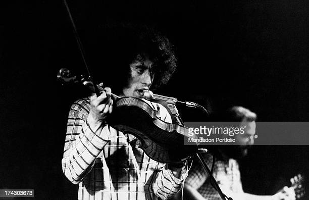 The Italian singersongwriter Angelo Branduardi clasps his violin and sings during a concert Italy 1977
