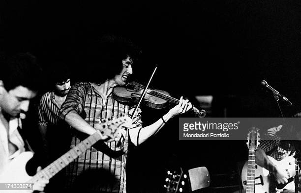 The Italian singersongwriter Angelo Branduardi plays the violin enthiusiastically during a concert Italy 1977