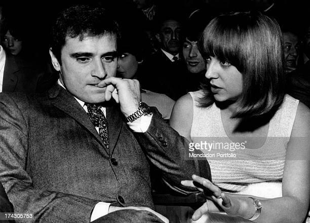The Italian singersongwriter Edoardo Vianello bites his nails seated next to his wife the Italian singer Wilma Goich 1967