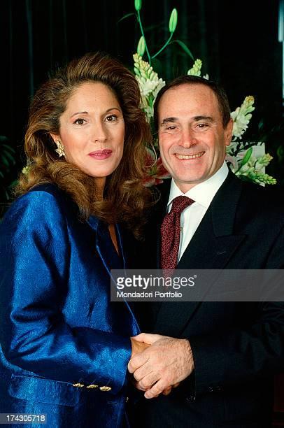 The Italian singersongwriter Edoardo Vianello poses smiling next to his second wife Vania Muccioli Italy 1990