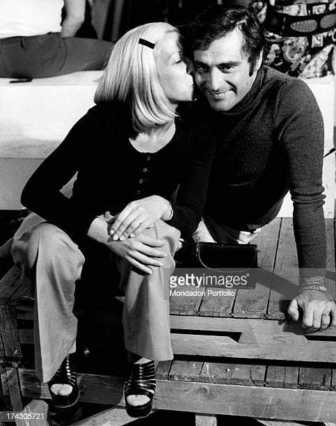 The Italian singersongwriter Edoardo Vianello poses with her first wife Wilma Goich an Italian singer who kisses him on his cheek they are attending...