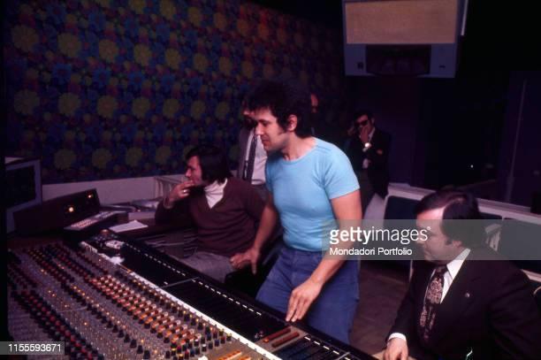 The Italian singersongwriter Lucio Battisti at the console of a recording studio Italy 1975