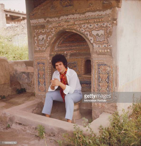 The Italian singersongwriter Lucio Battisti in the archaeological site of Pompeii Pompeii August 1969