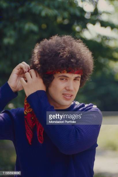 The Italian singersongwriter Lucio Battisti while arranging his scarf on the head Italy 1972