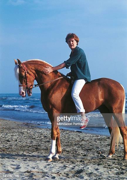 The Italian singersongwriter Umberto Tozzi on horseback on a beach 1987
