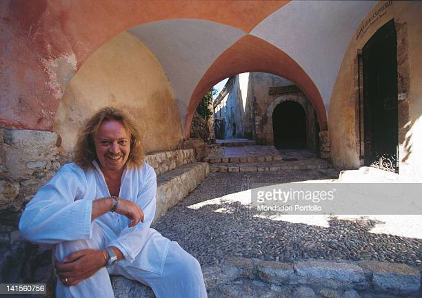 The Italian singersongwriter Umberto Tozzi posing and smiling near the entrance of the Chapelle de la Sainte Croix France 1999