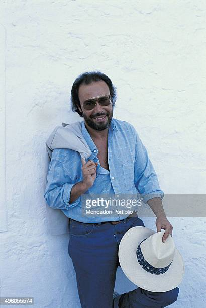 The Italian songwriter Antonello Venditti leaning against a wall during a photo shoot Italy 1986