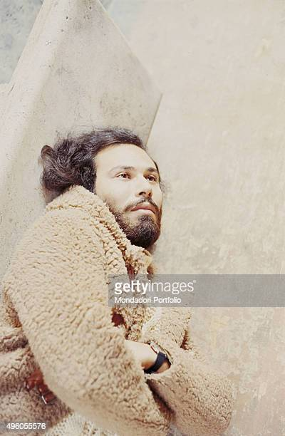 The Italian songwriter Antonello Venditti lying on a stone bench during a photo shoot Italy 1972