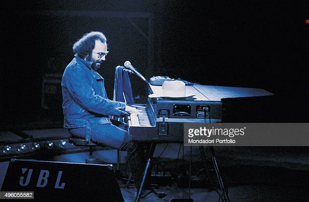 The Italian songwriter Antonello Venditti playing the piano during a concert Italy 1983