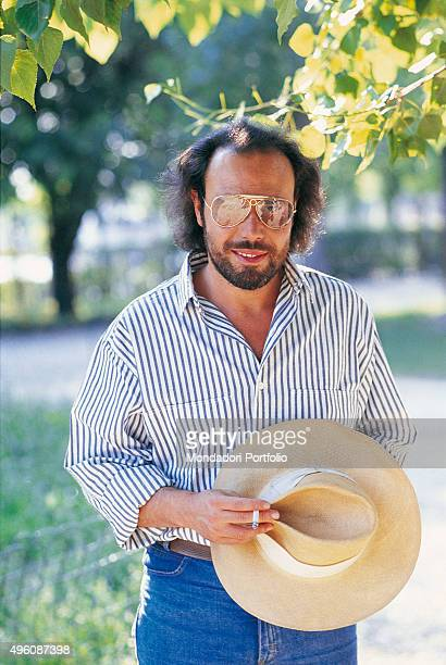 The Italian songwriter Antonello Venditti posing in a park during a photo shoot Italy 1984