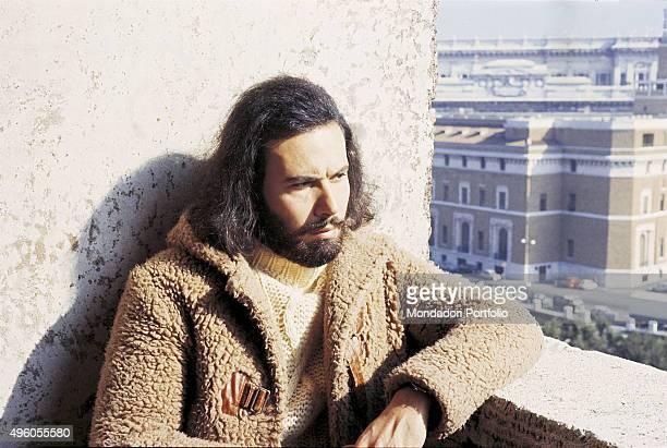 The Italian songwriter Antonello Venditti posing with an arm on a windowsill Photo shoot Italy 1972