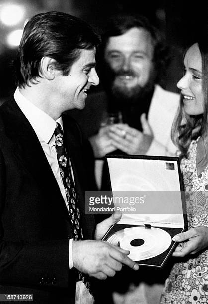 The Italian songwriter Sergio Endrigo is being awarded the Gold Record by the television presenter Aba Cercato Italy 1970