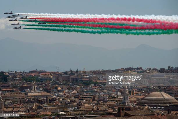 The Italian Special Air Force aerobatic unit 'Frecce Tricolori' spreads smoke with the colors of the Italian flag over the city of Rome during the...