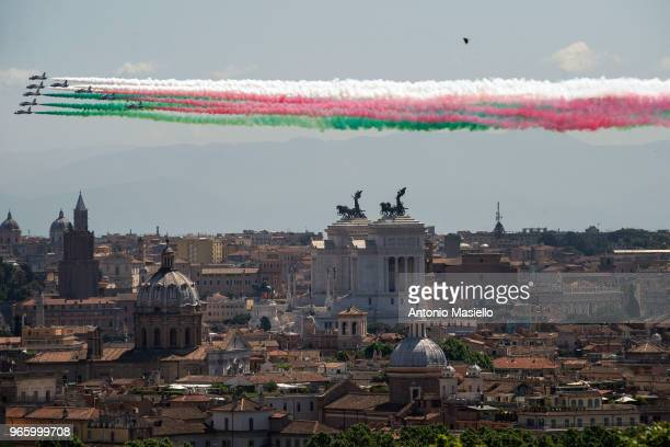The Italian Special Air Force aerobatic unit Frecce Tricolori spreads smoke with the colors of the Italian flag over the city of Rome during the...