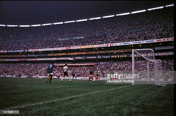The Italian striker Gianni Rivera partly hidden by the azzuro Angelo Domenghini is about to score the fourth goal in the semi final match of the...