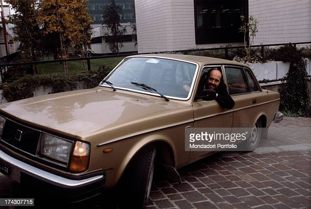 The Italian stylist Elio Fiorucci is inside his car and smiles The '80s